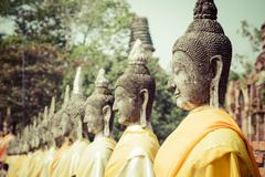aligned buddha statues at wat yai chaimongkol ayutthaya bangkok thailand - stock photo