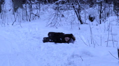Boy lying in the snow, clown, winter Stock Footage