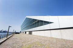 side view of the beautiful dockland building in hamburg, germany at the elbe  - stock photo