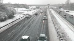 Heavy snowfall on German highway Stock Footage