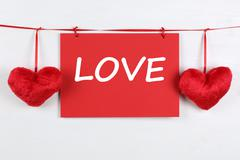 greeting card with word love on valentine's or mother's day with two hearts - stock photo