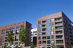 modern appartment buildings in the harbor of hamburg, germany. - stock photo