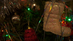 Multi-colored lights on a christmas tree. Close up - stock footage