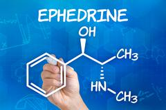 hand with pen drawing the chemical formula of ephedrine - stock illustration