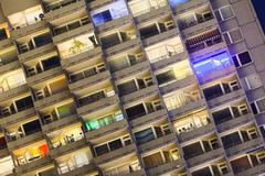 detail shot of a tall illuminated apartment building at europaplatz in aachen - stock photo