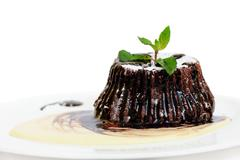 Stock Photo of Chocolate fondant with peppermint leaves