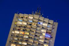 A tall illuminated apartment building at europaplatz in aachen, germany at ni Stock Photos