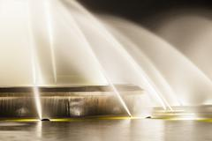 detail shot of the famous europaplatz fountain in aachen, germany at night - stock photo
