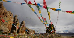4k Prayer flags at the lake namtso in tibet,ancient monk meditation in cave. Stock Footage
