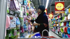 Woman go shopping in the department store in Chengdu, Sichuan, China - stock footage