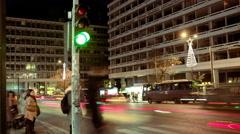 4K timelapse night pedestrians crossing traffic light urban christmas time Stock Footage