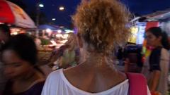 Woman at Walking Street on Night Market. Stock Footage