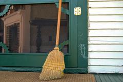 hobo chalk sign with broom - stock photo