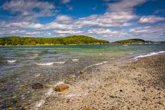 beach and view of islands in frenchman bay, bar harbor, maine. - stock photo