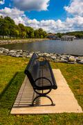 Bench along the shore of the north east river in north east, maryland. Stock Photos