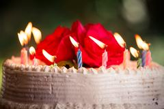 white creamy delicious cake with candles - stock photo