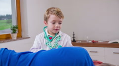 Young doctor using ear checker otoscope on patient Stock Footage