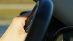 Mans hands close up making steering wheel rotation driving on turn Stock Footage