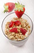 yogurt with crunchy cereal and strawberry - stock photo