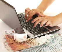 Earn money using your computer - stock photo