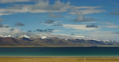 4k huge clouds mass rolling over lake namtso & snow mountain in tibet. Stock Footage