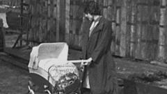 East Germany 1960's: mother in the street with a perambulator Stock Footage