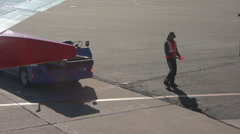 Baggage Handler on Runway Stock Footage