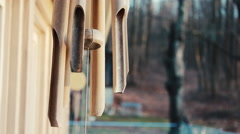 Wooden Wind Chimes on a farm during sunset - Terrence Malick style - stock footage