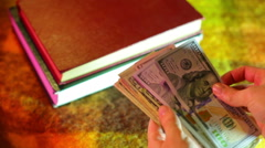 Stock Video Footage of money for books textbooks