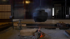 Pot over Fire in Traditional Japanese Indoor Hearth Stock Footage