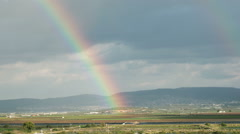 Moving Rainbow over the fields of Galilee, Israel with sun rays Stock Footage