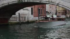 Venice Italy water taxi under small bridge 4K 017 Stock Footage