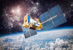 space satellite over the planet earth - stock photo