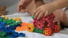 Asian child build a toy car with colorful block on the bed Stock Footage
