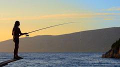 HD Slow-Mo: Adult Man Throws Fishing Tackles Stock Footage