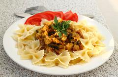 Farfalle with chicken fillet and mushrooms stew Stock Photos