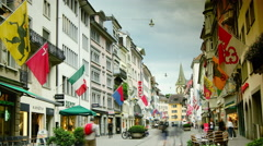 Old street in Zurich decorated with flags, time lapse, Stock Footage