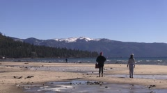 Grandma and grand daughter enjoying a day at frosty Lake Tahoe. Stock Footage