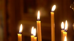 Beeswax Candles in a Church - stock footage
