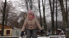 Girlsl playGirls playing on the snowing on the snow - stock footage