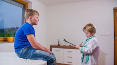 Kids playing doctor and patient at clinic - stock footage