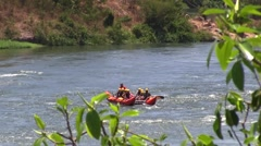 Rafting in rough waters the White Nile, Uganda (children) - stock footage
