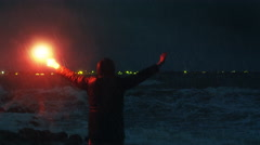 Man Waving with Signal Road Flare for Help in Storm Stock Footage