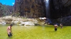 People enjoying the Waterfall on Canyons in a summer day in Minas Gerais, Brazil Stock Footage