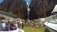 People enjoying the Waterfall on Canyons in a summer day in Brazil Stock Footage