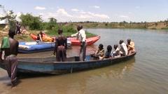 Ugandan people in the boat Stock Footage