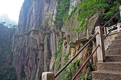 Hazardous pathway over the precipice in huang shan, china Stock Photos