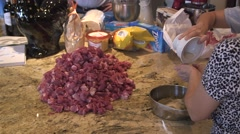 Adding seasoning to meat Stock Footage