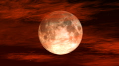 Red clouds move over the moon on a black sky Stock Footage