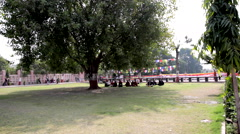 Buddhists sitting on the grass in a circle Stock Footage
